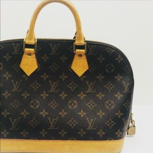Louis Vuitton Alma Handbag